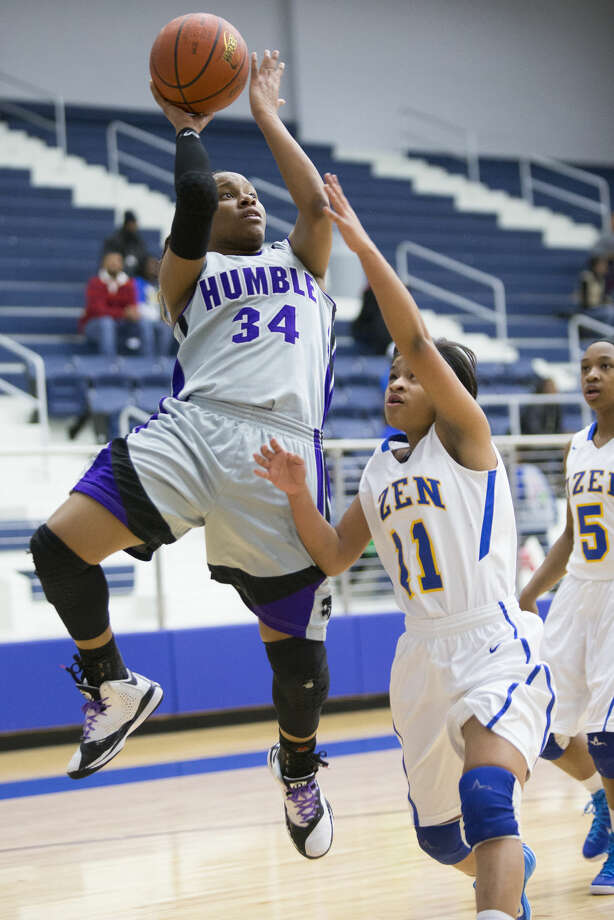 Humble's Karrington Donald (34) shoots an off-balance jumper during Humble's bi-district matchup against Ozen on Feb. 17, 2015, at Channelview High School. Photo: Andrew Buckley