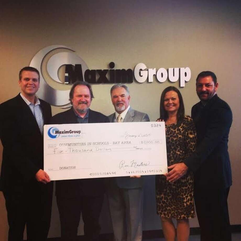 Peter Wuenschel (left), executive director of Communities in Schools-Bay Area, receives a sponsorship check from MaximGroup's (from left) Michael Clanton, director of business development; Ron W. Masters, president and CEO; Kimberly Fleming, executive producer; and Tony Placella, director of operations and IT systems. Photo: SUBMITTED PHOTO