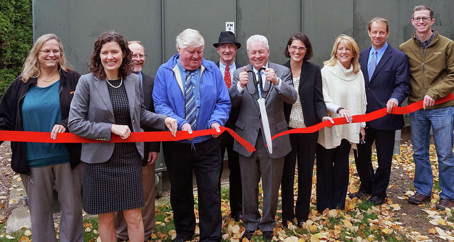 Local and state officials cut a ribbon in front of the generator at police headquarters on Reef Road in Fairfield, marking the installation of a microgrid there. Photo: Genevieve Reilly / Genevieve Reilly / Fairfield Citizen