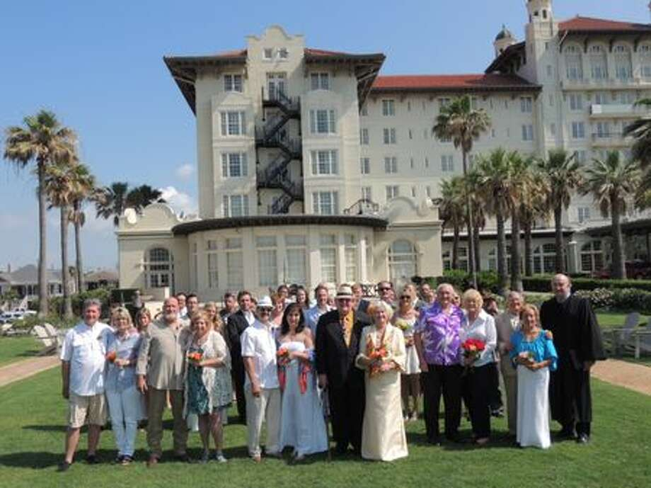 More than 20 couples participated in a wedding vow renewal ceremony hosted by Hotel Galvez & Spa and officiated by Judge Jim Schweitzer. Photo by Rhea's Photographic Art.