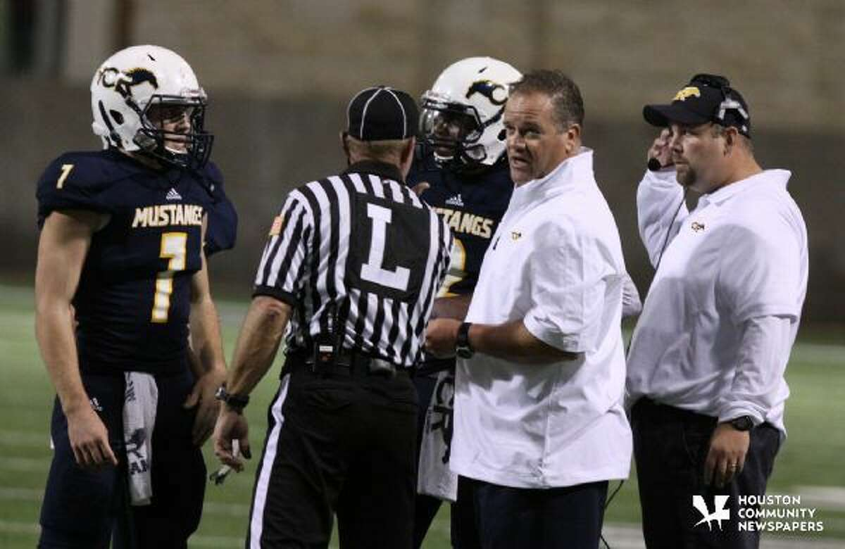 Coach Gene Johnson discusses a call with an official in the Cinco Ranch game.