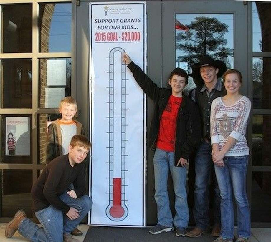 """The Coldspring-Oakhurst Education Foundation """"success thermometer"""" will gage the progress of funds raised. Pictured with the success thermometer are (left to right) Lincoln Junior High eighth-grader Travis Johnson (kneeling), James Street Elementary second-grader Logan Edwards, LJH eighth-grader Jarrod Siegfried, eighth-grader Ethan Benestante and Coldspring Intermediate fifth-grader Kynadee Benestante. Photo: Submitted"""