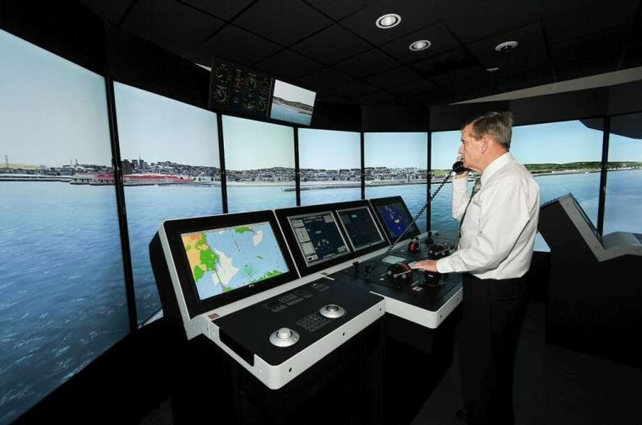 Capt. John Kessler, maritime instructor, demonstrates how mariners train using the bridge simulators at the San Jacinto College maritime program. Photo credit: Jeannie Peng-Armao, San Jacinto College marketing, public relations and government affairs department.