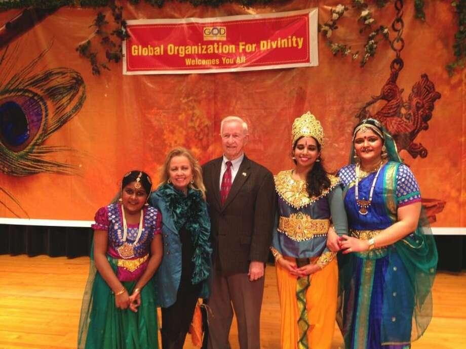 Pictured, left to right, are Nrithi Subramanian, Naomi Stevens (Pearland Arts League president), Mayor Tom Reid of Pearland, Shubha Soman (Lord Krishna), Surabi Veeraragavan (Princess Radha and choreography director).