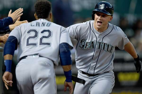 OAKLAND, CA - AUGUST 12:  Kyle Seager #15 and Robinson Cano #22 of the Seattle Mariners celebrates after Seager hit a solo home run against the Oakland Athletics in the top of the fifth inning at the Oakland Coliseum on August 12, 2016 in Oakland, California.  (Photo by Thearon W. Henderson/Getty Images)
