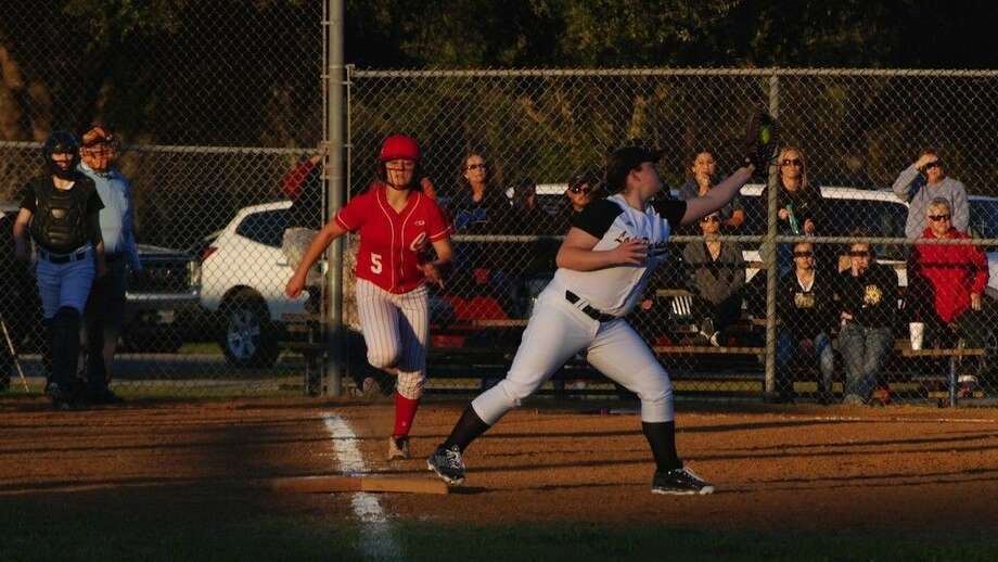 It didn't all go Crosby's way at Liberty, but the Lady Cougars won in the end, 6-5. Here first baseman Haylee Ford tags up to put out runner Brianna Ynfante. Photo: Casey Stinnett