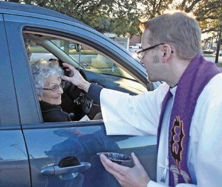 Reverend Pete Warmanen performs the Ash Wednesday ceremony to Sarah Backes Wednesday (February 18) at the House of Prayer Lutheran Church on Space Center Blvd. Photo: Kar B Hlava