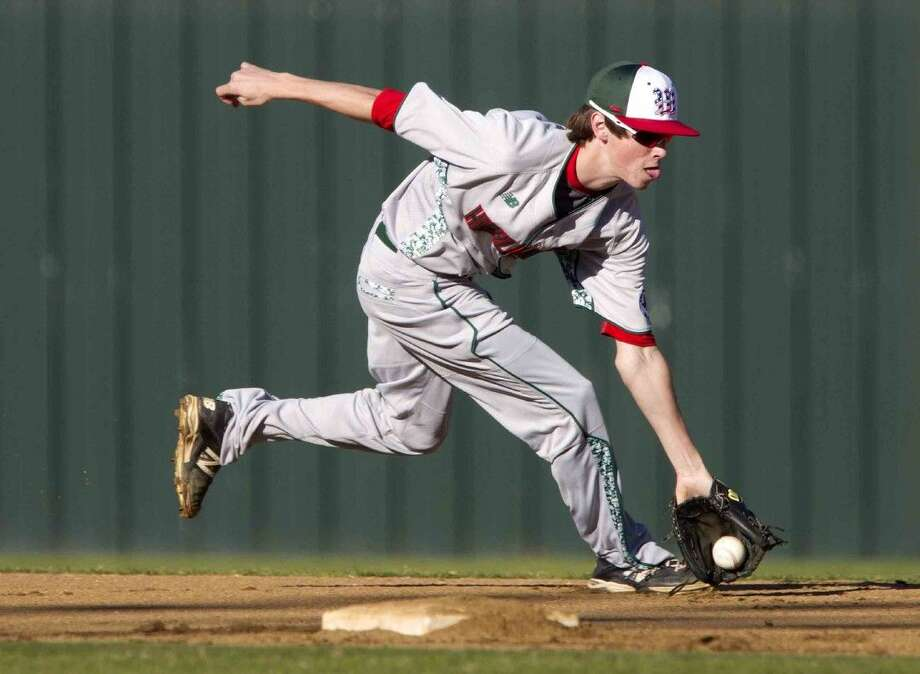 The Woodlands shortstop Alex Hale fields a ground ball during the team's inner squad scrimmage Thursday.