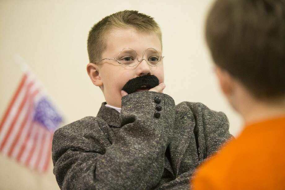 Brady Francis steadies his mustache while portraying Theodore Roosevelt during the Presidential and First Lady Living Wax Museum on Feb. 19, 2015, at Bens Branch Elementary in Porter. Photo: ANDREW BUCKLEY