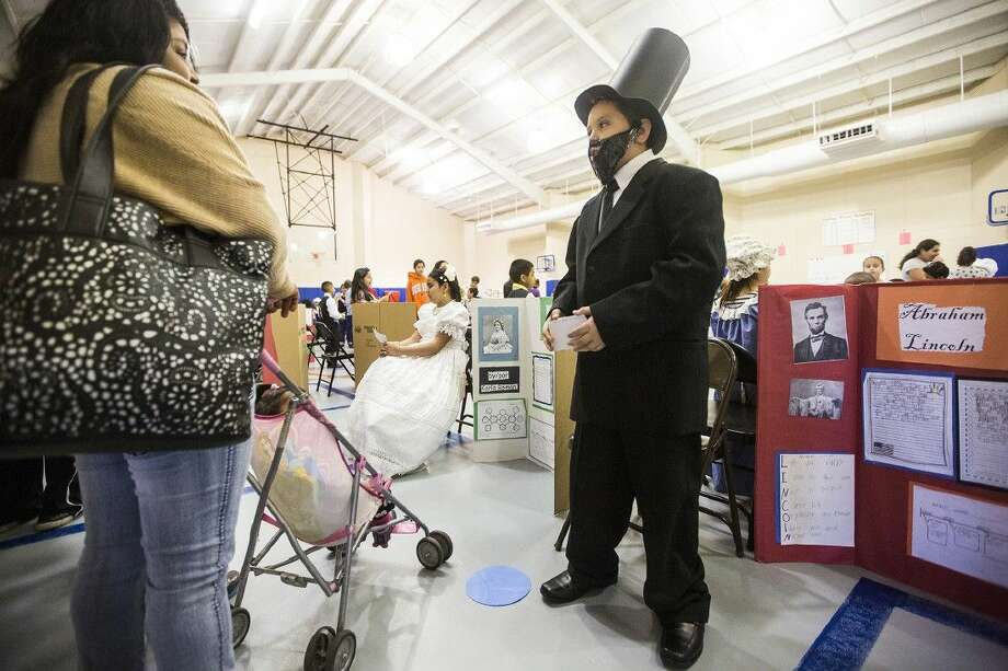 Diego Correa recites his biography of Abraham Lincoln in Spanish during the Presidential and First Lady Living Wax Museum on Feb. 19, 2015, at Bens Branch Elementary in Porter.