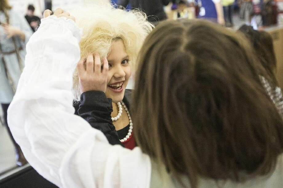 A student admires Paige Pazan's wig as she portrays Barbara Bush during the Presidential and First Lady Living Wax Museum on Feb. 19, 2015, at Bens Branch Elementary in Porter. Photo: ANDREW BUCKLEY