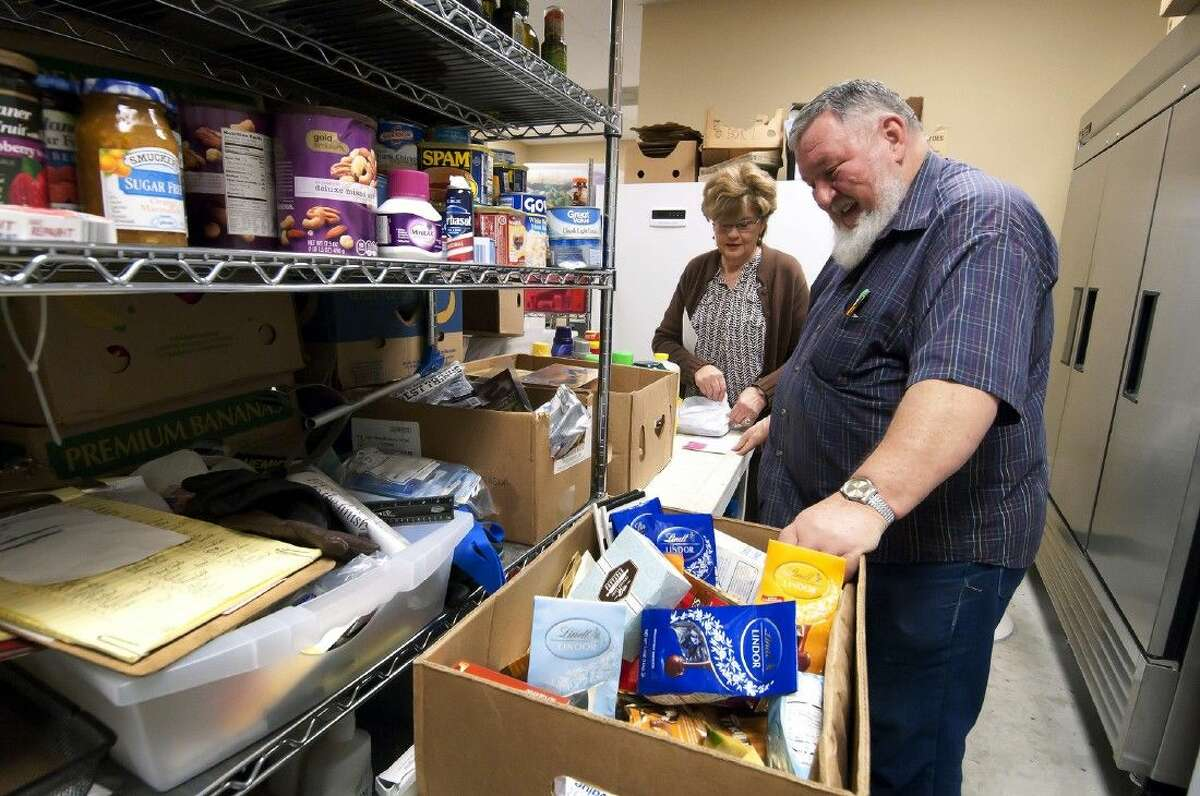 Jim Rice, coordinator, helps with packaging groceries on Tuesday, Feb. 17, for Lydia's Pantry.