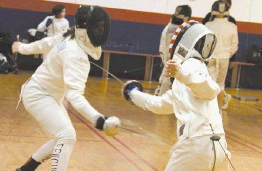 Jessica Thow, left, fences with Samantha Gaylor Feb. 5 at Alliance Fencing Academy located in Oak Ridge North.