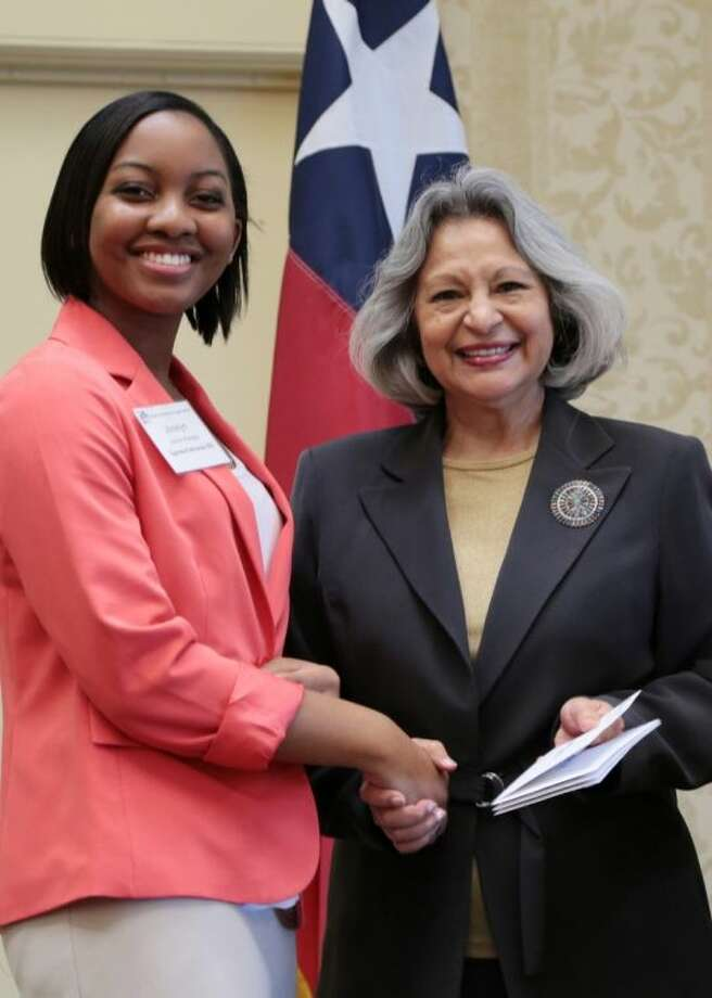 Viola M. Garcia, immediate past president of the Texas Association of School Boards (right), presents the TASB Partners scholarship award to Cypress Ranch High School senior Jocelyn Afadapa. Photo: Submitted Photo