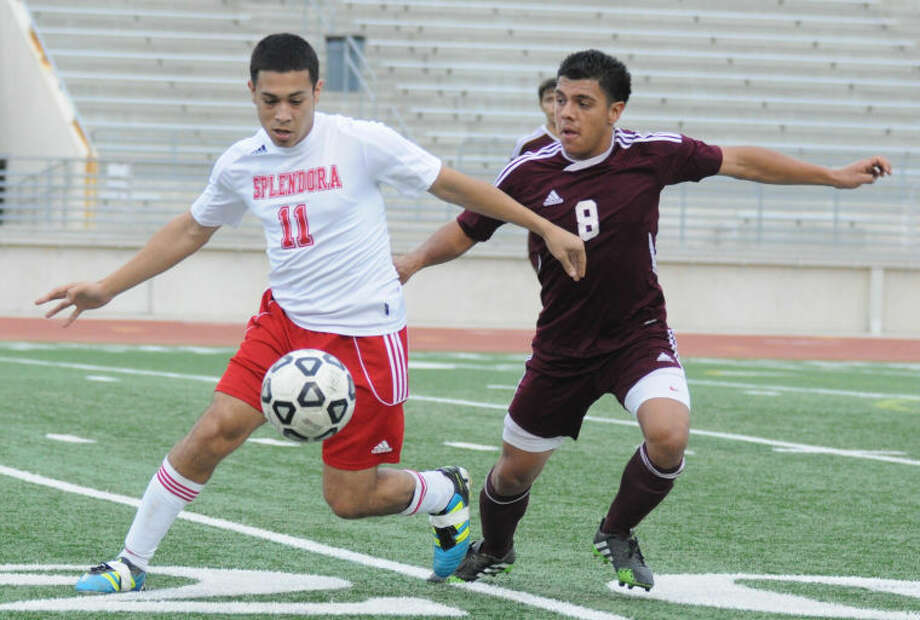 Splendora's Chris Melendez battles with a Beaumont Central player in a Region III-4A bi-district playoff game at Turner Stadium in Humble on Monday. Photo: Keith MacPherson