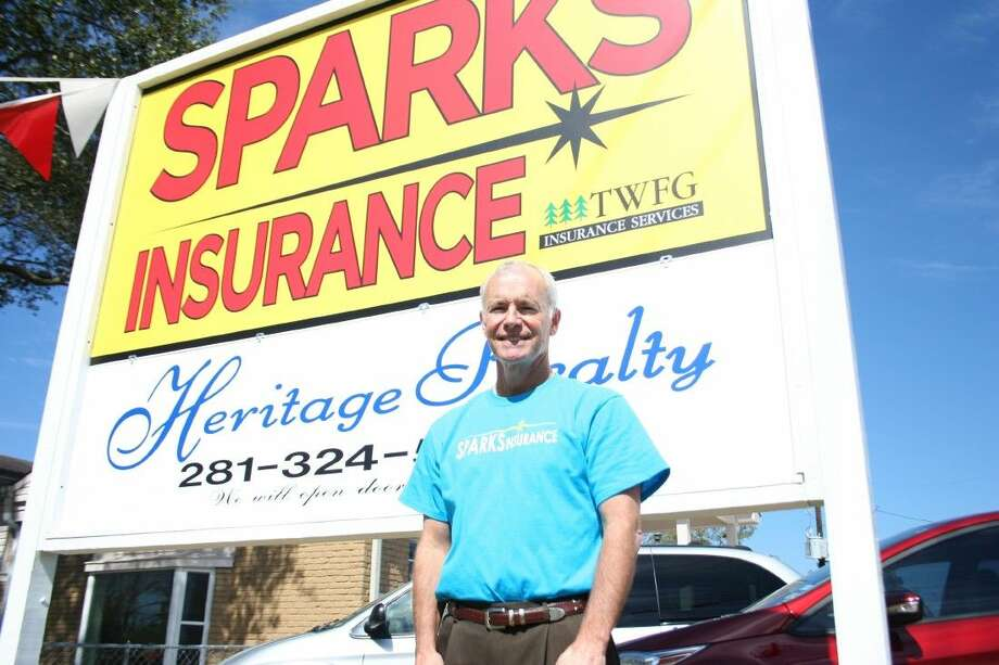 Huffman businessman John Sparks officially opened the new location of Sparks Insurance at a ribbon cutting ceremony Thursday. Photo: Nate Brown