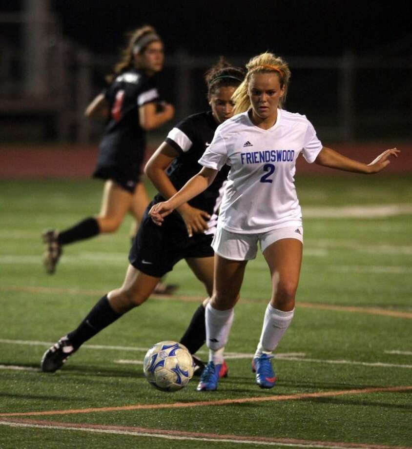 Friendswood junior forward Taylor Rue moves the ball up the field during a non-district game against Clear Brook Friday night. Rue scored twice Monday night to lead Friendswood to a 9-0 win over Houston Davis. Photo: KAR HLAVA