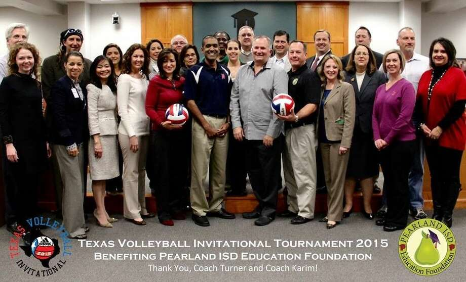 The Pearland ISD Education Foundation Board of Directors and PISD Head Volleyball Coaches John Turner and Jason Karim.