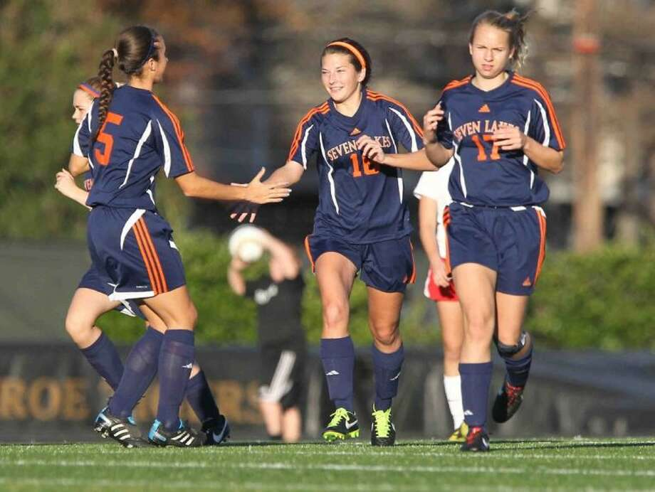 Seven Lakes' Bri Aheimer celebrates with teammates after scoring a goal during an early 2014 match. The Lady Spartans won the District 19-5A championship. To view or purchase this photo and others like it, visit HCNpics.com. Photo: Jason Fochtman