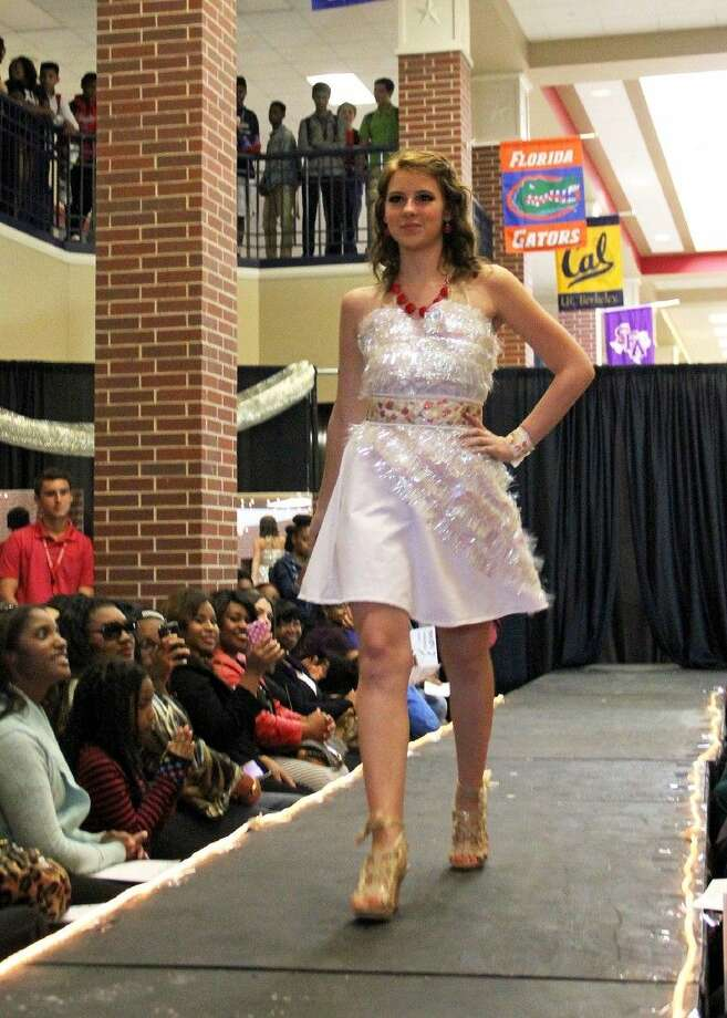 Dawson High School fashion student Bethany Theriot models an outfit created from holiday decoration during the school's December fashion show.