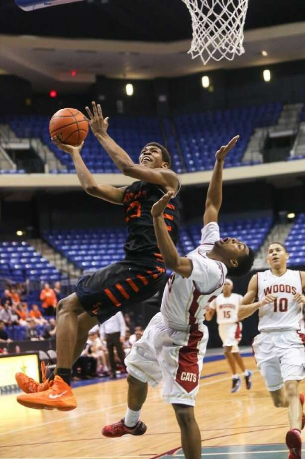 Seven Lakes' Kameron McGusty (23) shoots against Cy Woods' in the regional quarterfinals Feb. 25 at the Berry Center. To view or purchase this photo and others like it, go to HCNPics.com. Photo: Michael Minasi