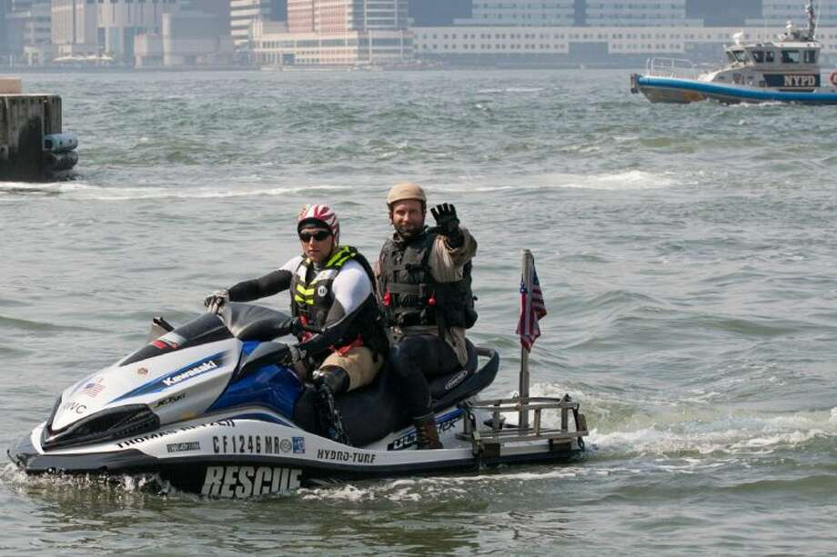 Former Navy SEALs Bo Reichenbach and Jared Ogden in a jet ski race series organized by Phoenix Patriot Foundation. Both will be in Houston April 5 for the foundation's Houston Benefit for Kilimanjaro to raise funds for an expedition by combat-wounded vets to summit Mount Kilimanjaro.