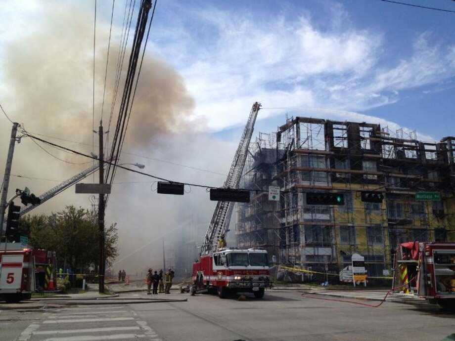 Firefighters battle a five-alarm fire Tuesday afternoon on West Dallas in the Montrose area. View the complete slideshow of all photos. Photo: Alan Warren