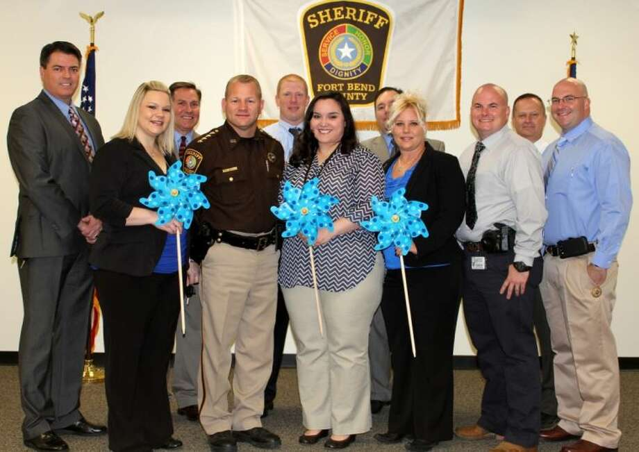 Members of the Crimes Against Children Unit preparing for The Pinwheel Project are (left-right) Sgt. David McKinnon, Detective Lesley Vaught, Criminal Investigation Division Captain James Burger, Sheriff Troy E. Nehls, and Detectives Jarrett Nethery, Julie Delgado, Tommy Thompson, Marshia Cox, Danny Brewster, Tim Morris and Ricky Holdsworth.