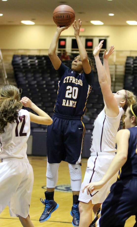 Cypress Ranch's Ariana Whitfield shoots against Cinco Ranch's Corin Evans during the Area Round Playoffs, Feb. 20 at Coleman Coliseum in Houston. Cy Ranch won the game to advance 63-54. To view or purchase this photo and others like it, go to HCNPics.com. Photo: Staff Photo By Alan Warren