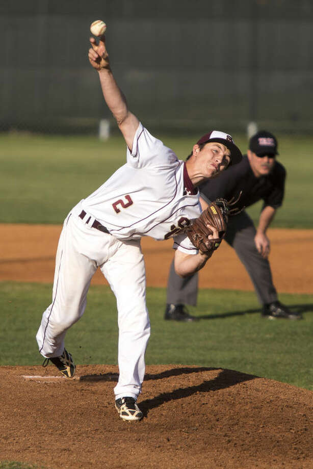 Summer Creek'sKeegan Bear pitches during Summer Creek's 2-1 victory over New Caney on March 25, 2014, at Summer Creek High School. (Photo by ANDREW BUCKLEY/The Observer) Photo: ANDREW BUCKLEY