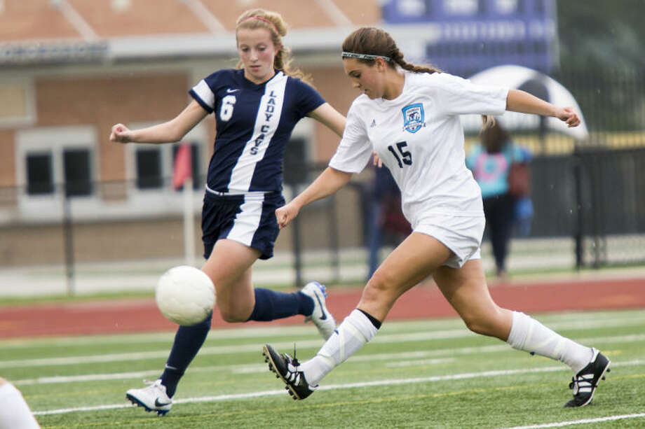 Kingwood's Kennedy Brown shoots and scores during Kingwood's playoff matchup against College Park on March 28, 2014, at Turner Stadium in Humble. (Photo by ANDREW BUCKLEY/The Observer)