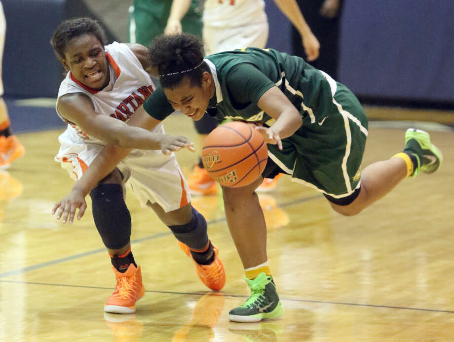 Seven Lakes' Michelle Fokam battles Cypress Falls' Ja'Qayza Cleveland for the ball during the Area Round Playoffs, Feb. 20 at Coleman Coliseum in Houston. Seven Lakes won 56-39. To view or purchase this photo and others like it, go to HCNPics.com.