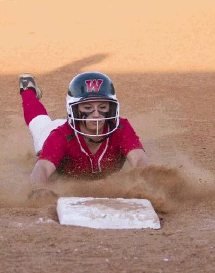 The Woodlands' Aubrey Leach slides into third base during a District 14-5A game against Conroe on Tuesday at Conroe High School. The Lady Highlanders won 14-1. To view or purchase this photo and others like it, visit HCNpics.com. / The Conroe Courier/ The Woodland