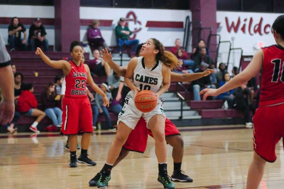 Hightower's Dyamond Puebla (10) fields a rebound Dec. 4 against Clear Brook in the Peggy Whitley Classic. The Lady Hurricanes defeated Pearland on Feb. 20 to advance to the Region III-6A quarterfinals. Photo: Kirk Sides