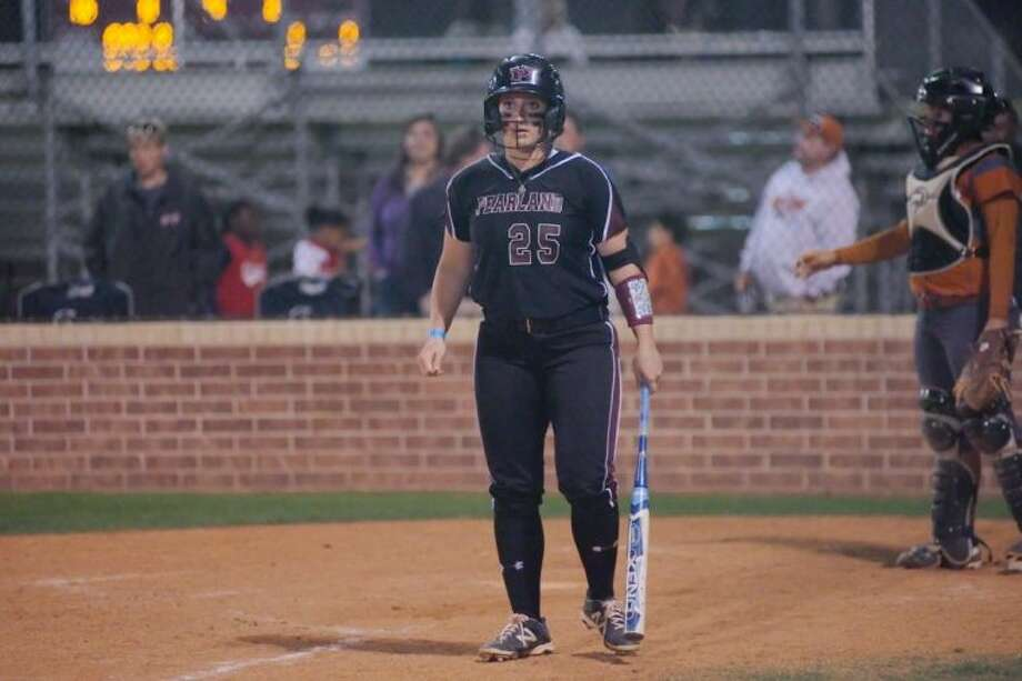 Pearland's Rylie Spell looks down the third base line toward head coach Laneigh Clark just prior to hitting her two-run home run in the Lady Oilers' 5-3 win Tuesday over Pasadena Dobie. Photo: KIRK SIDES