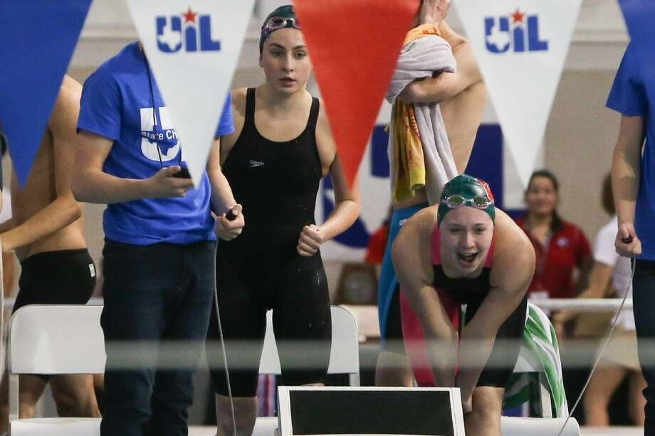 The Woodlands teammates cheer while competing in the 200-yard medley relay during the Class 6A UIL State Swimming and Diving Championships on Saturday at the Lee and Joe Jamail Texas Swimming Center in Austin. To view more photos from the tournament, check out the photo galleries on HCNPics.com.