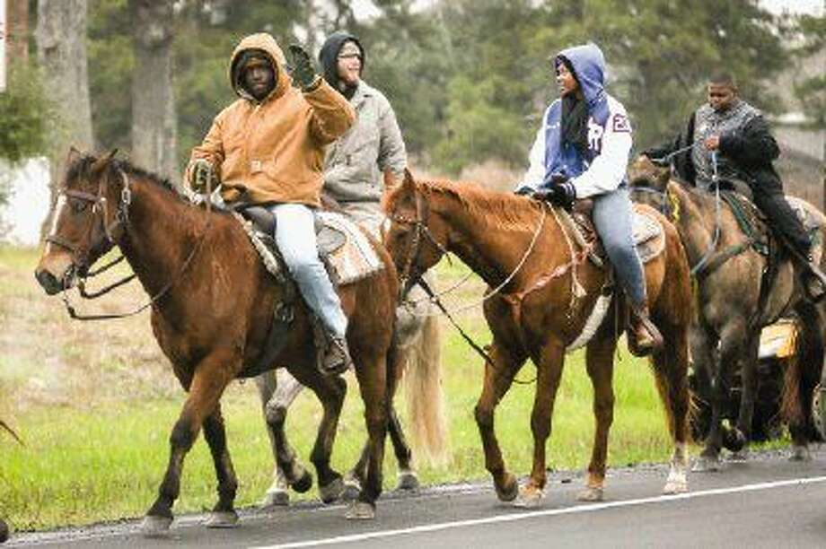Traile riders make their way down Texas 75 in Willis on Monday. Photo: Michael Minasi
