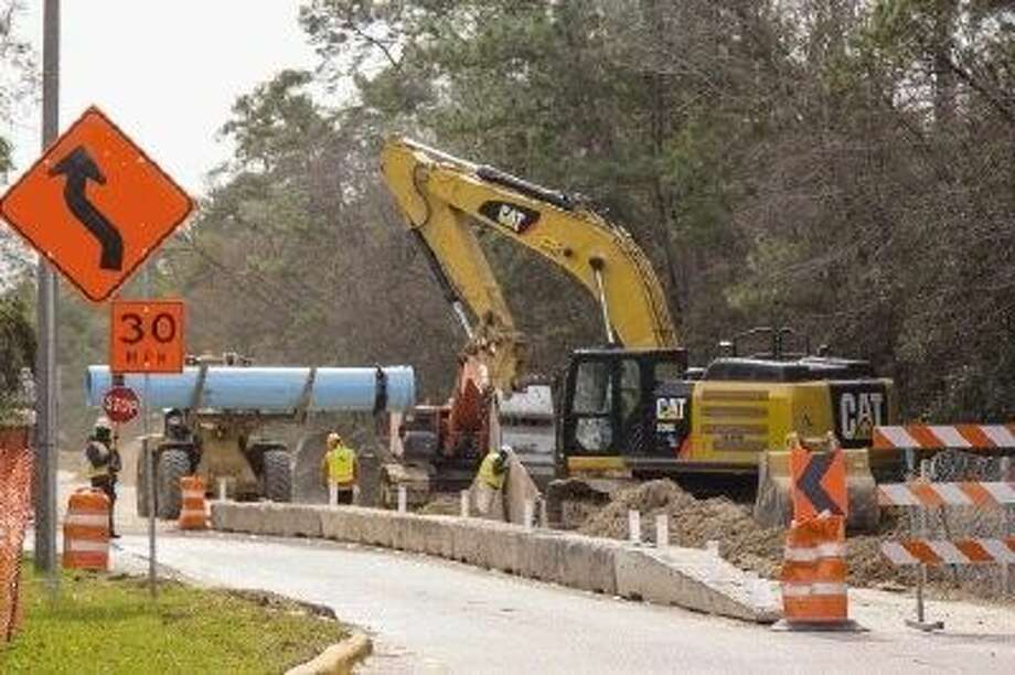 In this 2014 file photo, construction crews work on a water pipeline near the intersections of North Millbend Drive and Grogan's Mill Road in The Woodlands.