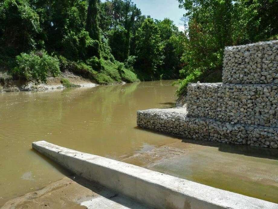 Mercer's new canoe launch features a 37-foot-long, four-foot-tall retaining wall and sidewalk to prevent erosion to the creek bank and improve safety for creek paddlers.