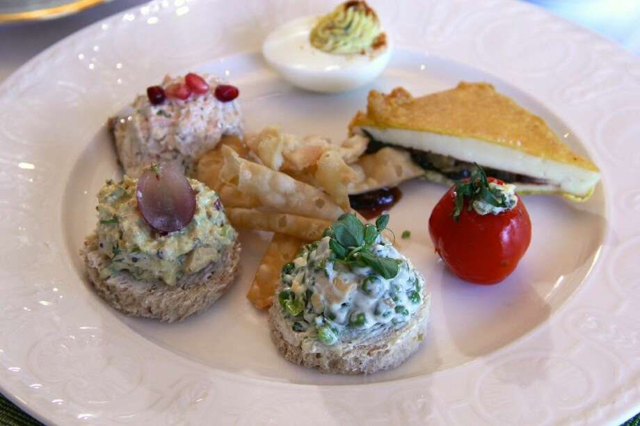 A plate full of tasty finger sandwiches like Waldorf Chicken Salad and Tandoor-Smoked Salmon with Dill makes of the second course of High Tea at Kiran's High Tea on Saturdays.