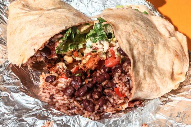 Chipotle is officially adding chorizo, a spicy chicken-and-pork sausage, to its menu.