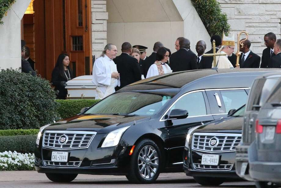 Caskets are brought out at the end of the memorial service for Rev. Israel, Dorcus, and Jay Ahimbisibwe at The Church of St. John the Divine in Houston, Texas on Thursday, February 19, 2015. Photo: Staff Photo By Alan Warren