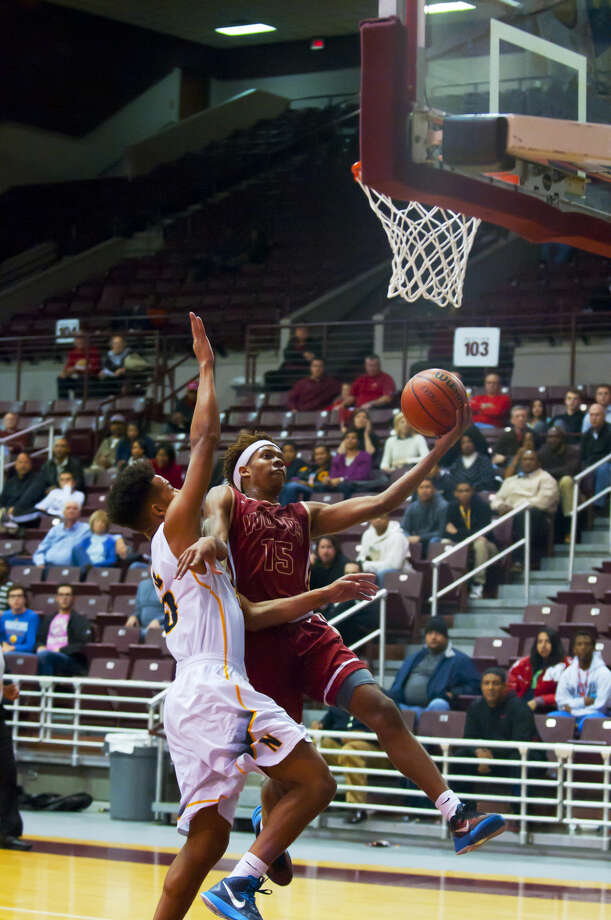Cy Woods' Jhealan Wesley attacks the basket against Nimitz on Tuesday at the Campbell Center. Photo: Tony Gaines/HCN