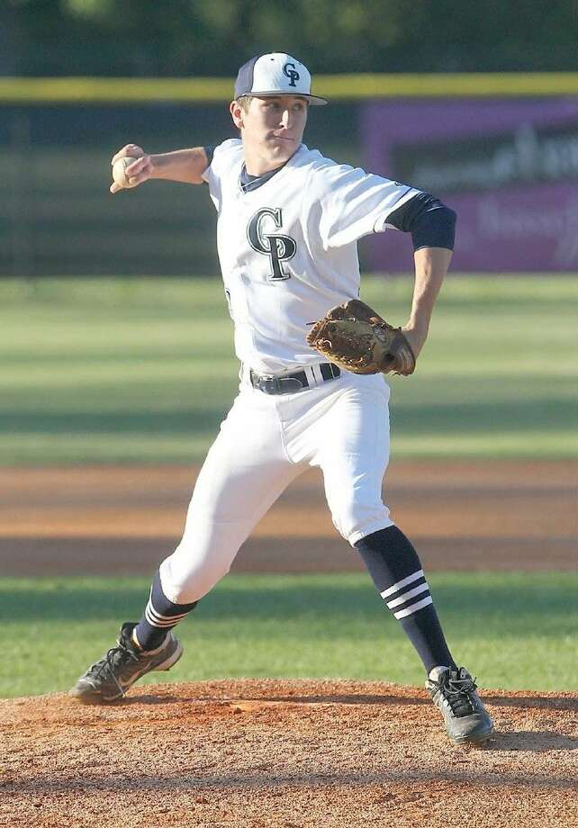 College Park pitcher Beau Ridgeway (12) attempts a pickoff during a high school baseball game last season.