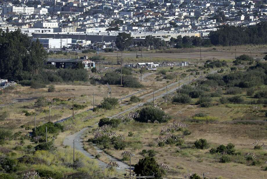 An old railroad right-of-way slices through open space land between Bayshore Boulevard and Highway 101 in Brisbane, Calif. on Thursday, Sept. 3, 2015. The Baylands mixed-use development project is planned for the 660-acre site. Photo: Paul Chinn, The Chronicle