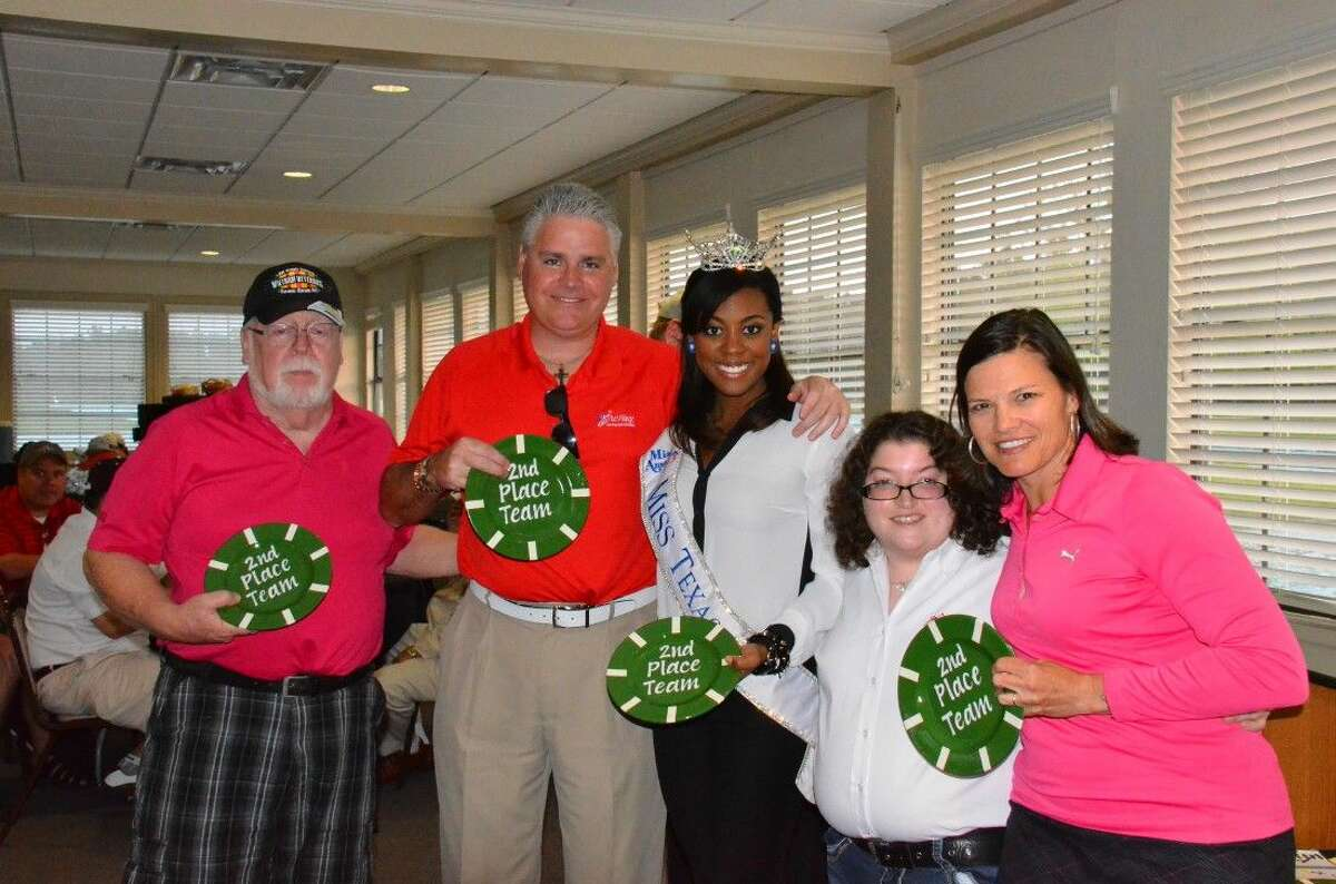 State Representative Dan Huberty and his team, along with the help of Golf Pro Lori Tatum, from Kingwood Golf Advantage School pose with Miss Texas 2013, Ivana Hall and Villager Kaylyn West as they get their trophies for second place.