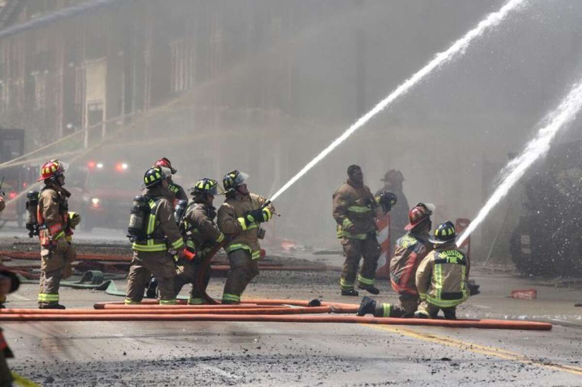 Houston firefighters battle a 5-alarm fire as it burns a 368 unit apartment complex under construction at the 2400 block of West Dallas near Montrose in Houston, Texas on Tuesday, March 25, 2014.