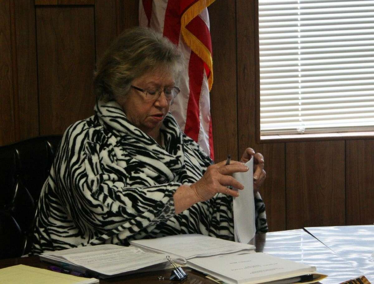 San Jacinto County Auditor Carole Martin explains the purpose of the DETCOG grant for the baler.