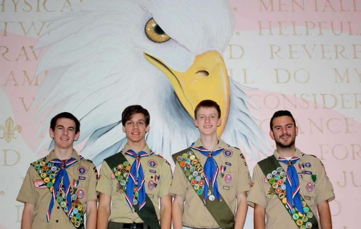 Boy Scout Troop 230 congratulates John Eenink, Hillis Gussett, James Netland, and Asa Grimsley (pictured left to right) on earning the rank of Eagle Scout.
