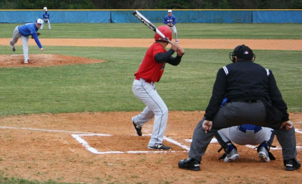One of the Lumberjacks braces himself for a pitch from Pirate Stephen Kolek.